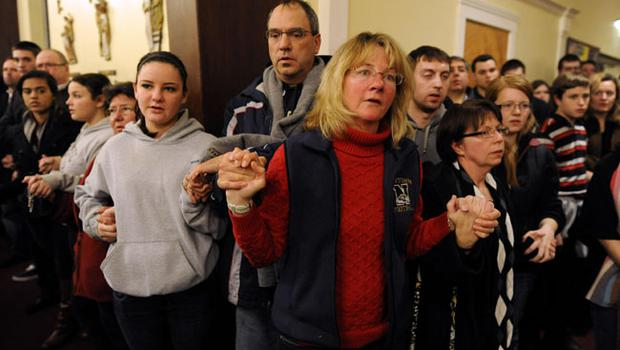 Mourners gather inside the St. Rose of Lima Roman Catholic Church at a vigil service for victims of the Sandy Hook Elementary School shooting that left at least 27 people dead, many of them young children, in Newtown, Conn. Friday, Dec. 14, 2012. Police have identified the gunman as Adam Lanza, whose mother was a teacher at the school. (AP Photo/Andrew Gombert, Pool)