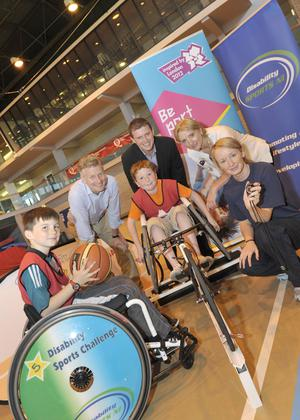 Paul Deighton, chief executive of the London Organising Committee of the Olympic Games, joins local children to promote the Disability Sports challenge ahead of the 2012 Games