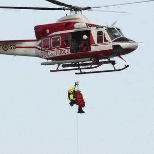 An Italian firefighter helicopter rescues a person from the luxury cruise ship Costa Concordia (AP)