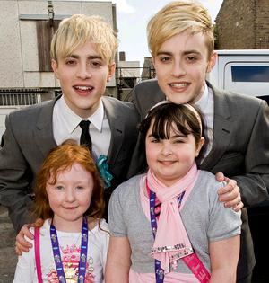 Fans Aoife Kavanagh (9) and Shauna Carter (9)with Jedward at the making of an advert for Abrakebabra in Dublin
