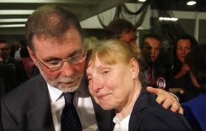 An emotional Nelson McCausland and wife Mary are overcome with joy after being elected for North Belfast on the first count at Valley Leisure Centre for the Northern Ireland Assembly election