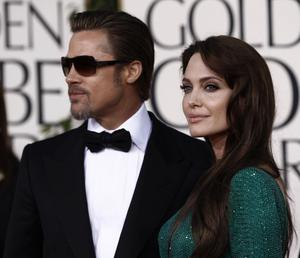 Angelina Jolie and her husband Brad Pitt, left, arrive for the Golden Globe Awards Sunday, Jan. 16, 2011, in Beverly Hills, Calif. (AP Photo/Matt Sayles)