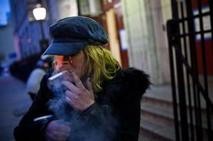 NEW YORK, NY - OCTOBER 28:  Mary McSweeney, who is staying at the evacuation center stationed inside Seward Park High School, has a cigarette prior to the arrival of Hurricane Sandy, on October 28, 2012 in New York City. Sandy, which has already claimed over 50 lives in the Caribbean, is predicted to bring heavy winds and floodwaters as the mid-atlantic region prepares for the damage.  (Photo by Andrew Burton/Getty Images)