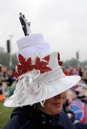 LONDON, ENGLAND - APRIL 29:  A women wearing a Wedding Cake hat poses for the camera in Hyde Park as she waits to watch the Royal Wedding of Prince William to Catherine Middleton at Westminster Abbey on April 29, 2011 in London, England. The marriage of the second in line to the British throne is to be led by the Archbishop of Canterbury and will be attended by 1900 guests, including foreign Royal family members and heads of state. Thousands of well-wishers from around the world have also flocked to London to witness the spectacle and pageantry of the Royal Wedding.  (Photo by Christopher Lee/Getty Images)
