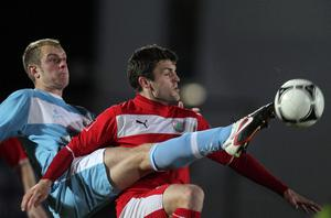 Ballymena's Johnny Taylor wins this battle for possession in the Shield encounter