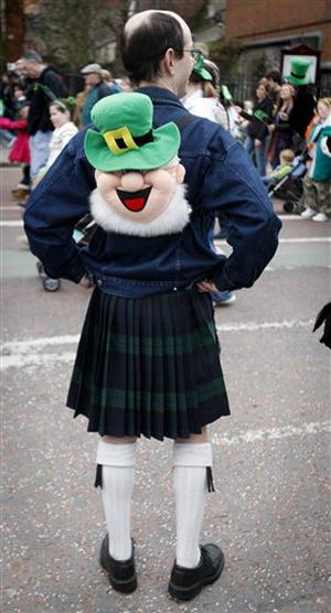 A man watches the St Patrick's day parade in Belfast, Northern Ireland, Tuesday, March, 17, 2009. (AP Photo/Peter Morrison)