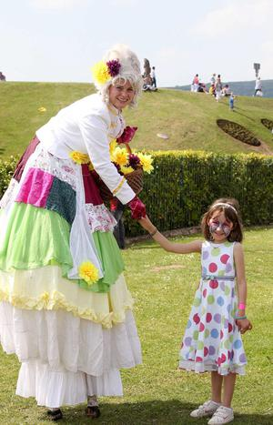 22nd May 2010.  Children's festival in the Waterworks in north Belfast.  Seven-year-old Libby Maloney from Belfast meets one of the circus characters in the park.