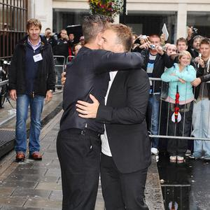 Robbie Williams and Gary Barlow arrive at Radio 1 in London