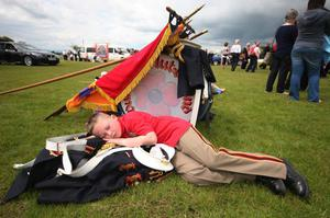 This young boy falls asleep in the warm sunshine at The Independents parade in Ballymoney.
