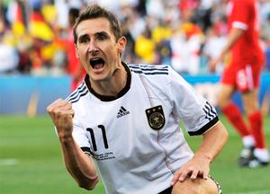 Miroslav Klose of Germany celebrates scoring the opening goal during the 2010 FIFA World Cup South Africa Round of Sixteen match between Germany and England at Free State Stadium on June 27, 2010 in Bloemfontein, South Africa