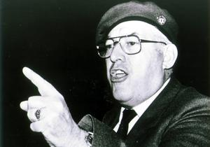 Former DUP leader Ian Paisley wearing the traditional red beret of paramilitary group the Ulster Resistance in Ulster Hall