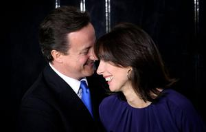 Prime Minister David Cameron and wife Samantha Cameron stand on the steps of Downing Street