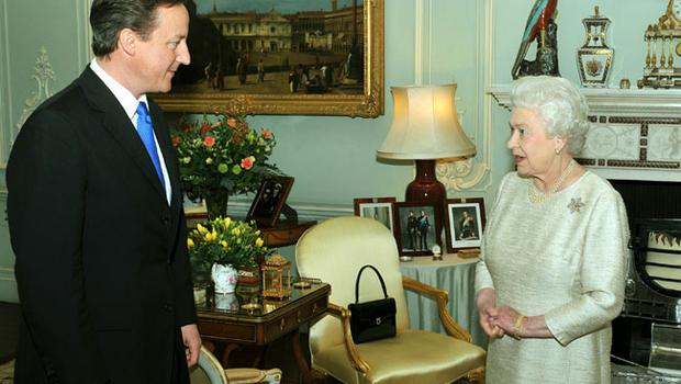 Britain's Queen Elizabeth II greets David Cameron at Buckingham Palace in an audience to invite him to be the next Prime Minister