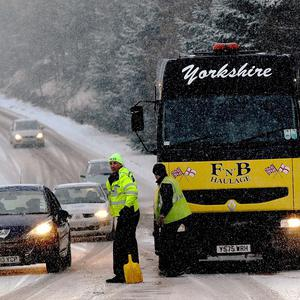 A 'perfect storm' of freezing rain falling on icy roads has caused multiple collisions on the UKs roads