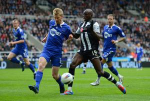 NEWCASTLE UPON TYNE, ENGLAND - APRIL 09: Demba Ba of Newcastle is tackled by Tim Ream of Bolton during the Barclays Premier League match between Newcastle United and Bolton Wanderers at the Sports Direct Arena on April 9, 2012 in Newcastle upon Tyne, England.  (Photo by Michael Regan/Getty Images)