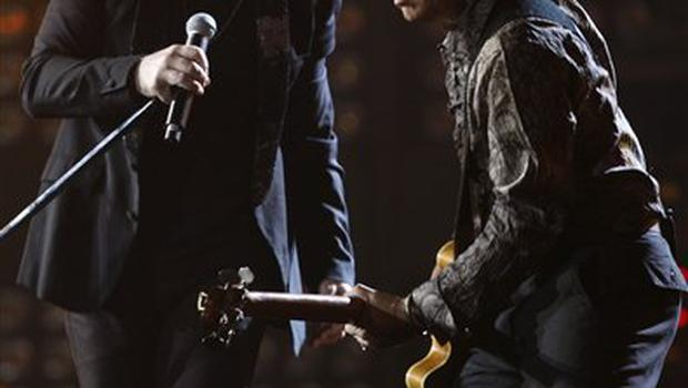 Bono, left, and Adam Clayton from Irish band U2 perform at the Brit Awards 2009 at Earls Court exhibition centre in London, England, Wednesday, Feb. 18, 2009. (AP Photo/MJ Kim)