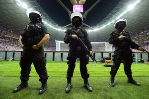 WARSAW, POLAND - JUNE 12:  Police in riot gear stand inside the stadium during the UEFA EURO 2012 group A match between Poland and Russia at The National Stadium on June 12, 2012 in Warsaw, Poland.  (Photo by Shaun Botterill/Getty Images)