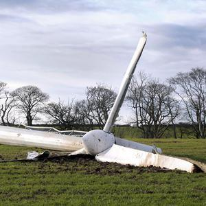 A wind turbine near Coldingham, Scotland, lies on its side after high winds brought it down