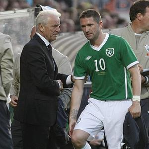Robbie Keane (right) says Giovanni Trapattoni is safe as Ireland boss