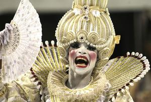 A dancer performs during the parade of  Vai-Vai samba school in Sao Paulo, Brazil, Saturday, Feb. 18, 2012. (AP Photo/Andre Penner)