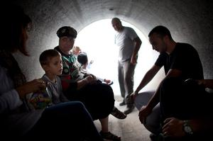 NITZAN, ISRAEL - NOVEMBER 19:  (ISRAEL OUT)  Israelis take cover in a large concrete pipe used as a bomb shelter during a rocket attack from the Gaza Strip on November 19, 2012 in Nitzan, Israel. According to reports November 19, 2012, at least 90 Palestinians have been killed and more than 700 wounded during the Israeli offensive in the Gaza Strip.  (Photo by Uriel Sinai/Getty Images)