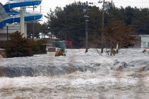 An area is flooded by tsunami in Iwaki as Japan was struck by a magnitude 8.9 earthquake
