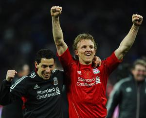 LONDON, ENGLAND - FEBRUARY 26:  Dirk Kuyt and Maxi Rodriguez of Liverpool celebrate victory after the Carling Cup Final match between Liverpool and Cardiff City at Wembley Stadium on February 26, 2012 in London, England. Liverpool won 3-2 on penalties.  (Photo by Mike Hewitt/Getty Images)