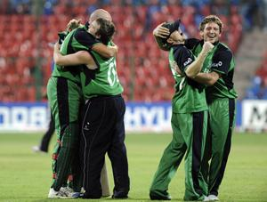 Ireland celebrate winning during the ICC Cricket World Cup match at the at M Chinnaswamy Stadium, Bangalore, India. P