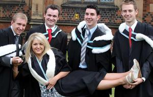 Graduations at Queen's University Belfast.  Left to right.  Stephen Muckle from Glengormley, Daniel Hendry from Bangor, Chris Hopkins from Ballycare, Paul McAdam from Aghalee hold Laura O'Neill from Belfast who graduated with a BA Hons in History.