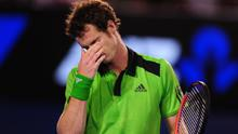 Great Britain's Andy Murray shows his dejection against Serbia's Novak Djokovic in the Men's Final during day fourteen of the 2011 Australian Open at Melbourne Park in Melbourne, Australia.