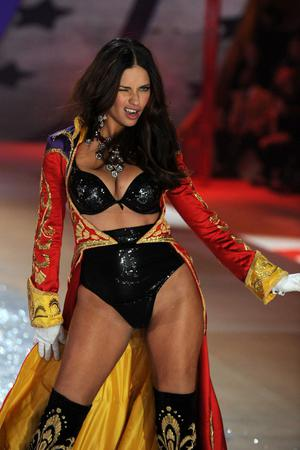 NEW YORK, NY - NOVEMBER 07:  Adriana Lima walks the runway during the Victoria's Secret 2012 Fashion Show on November 7, 2012 in New York City.  (Photo by Bryan Bedder/Getty Images for SWAROVSKI ELEMENTS)