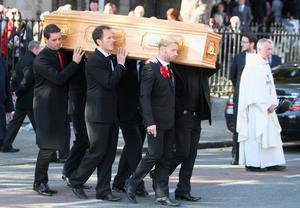 Ronan Keating, Keith Duffy Mikey Graham and Shane Lynch carry out the coffin after the funeral of Boyzone singer Stephen Gately at St Laurence O'Toole Church in Dublin