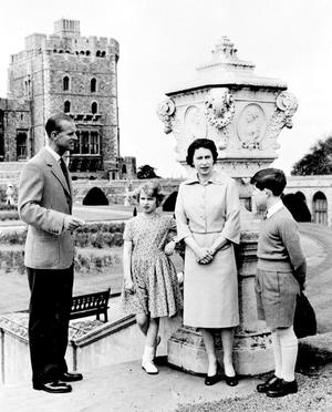 1959:  Britain's Queen Elizabeth II and her husband, the Duke of Edinburgh, stand with Prince Charles and Princess Anne at the top of the East Terrace Garden steps at Windsor Castle. PA Photo.