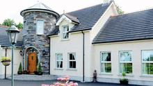 <B>50: 43 AIRFIELD ROAD, TOOMEBRIDGE</b><br/> Price: £499,000<br/> Agent: BTWCairns, tel 9066 8888<br/> An unusual family abode in the heart of Co Antrim <br/> The five-bedroom house has modern open plan accommodation with five reception rooms, so no scrimping on space here. The grand exterior includes a stone-pillared entrance adding country house credentials while the smart interior layout is very 21st century.<br/> With three en suites and a main bathroom, this is a perfect place for a family to grow up.<br/> There is a fine finish inside with porcelain-tiled floor to the hall, oak and lime fireplaces to the living areas, a kitchen with designer tiling and appliances, a family room with cast iron stove and full-height stone fireplace.<br/> The main bedroom has a dressing area and is open plan to an en suite with jet shower. The second has built-in wardrobes. With another en suite in bedroom four and a free-standing bath to the bathroom, it is one impressive property. With office space above the integral double garage, it's perfect for work and play.