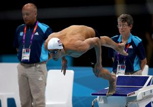 Michael Phelps of the United States dives off of the block at the start of heat 5 of the Men's 200m Butterfly on Day 3 of the London 2012 Olympic Games