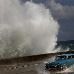 A wave crashes against the Malecon in Havana, Cuba (AP)