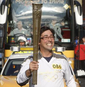 Going for gold: Colin Murray with the flame