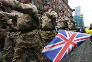 The British Army's Royal Irish Regiment parades through Belfast city center, Northern Ireland, Sunday, Nov. 2, 2008. Riot police kept apart rival loyalist and Republican supporters at a parade to honor Northern Ireland members of British armed forces that have recently returned from war zones in Iraq and Afghanistan.  (AP Photo/Peter Morrison)