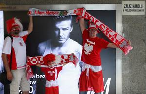 WARSAW, POLAND - JUNE 12: Polish fans watched over by David Beckham ahead of  the UEFA EURO 2012 group A match between Poland and Russia at The National Stadium on June 12, 2012 in Warsaw, Poland.  (Photo by Michael Steele/Getty Images)