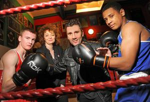 Punch perfect: Sports Minister Carál Ní Chuilín, Wayne McCullough with boxers Conor Martin (left) and Caoimhin Hynes at Holy Trinity ABC to announce the visit of the Cuban boxers
