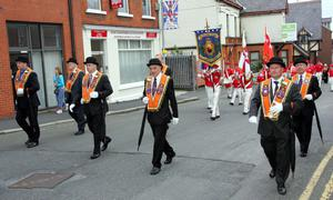 Lurgan District Officers lead the Twelfth parade through the town. Picture By Rick Hewitt. 12/7/11.
