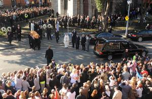 Boyzone members  carry the coffin of Stephen Gately outside St Laurence O'Toole Church in Dublin
