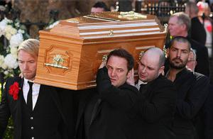 Boyzone members Ronan Keating (front left), Mikey Graham (front right) and Shane Lynch (back right) carry the coffin of Stephen Gately outside St Laurence O'Toole Church in Dublin