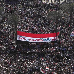 Egyptians celebrating after president Hosni Mubarak's departure (AP)