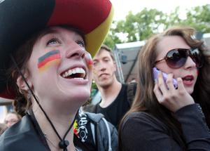 BERLIN, GERMANY - JUNE 09:  German team fans wait for the start of the Germany versus Portugal UEFA Champions League soccer match, broadcast from Lviv, Ukraine on a giant outdoor screen near the Brandenburg Gate on June 9, 2012 in Berlin, Germany. The 2012 UEFA European Football Championship, also known as Euro 2012, is a 16-team tournament that Poland is co-hosting with Ukraine. Germany beat Portugal 1-0.  (Photo by Adam Berry/Getty Images)