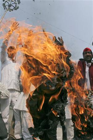 Supporters of Socialist Party burn an effigy of a terrorist involved in Mumbai shooting, in Allahabad, India, Thursday, Nov. 27, 2008. Teams of gunmen stormed luxury hotels, a popular restaurant, a crowded train station and a Jewish group's headquarters, killing people, and holding Westerners hostage in coordinated attacks on the nation's commercial center that were blamed on Muslim militants. (AP Photo/Rajesh Kumar Singh)
