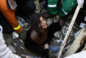 A member of the Abdel Aal family is rescued after their house collapsed during an Israeli forces strike in the Tufah neighbourhood, Gaza City, Sunday, Nov. 18, 2012