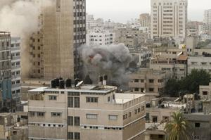 Smoke is seen  from an explosion by a high rise housing media organizations in Gaza City, Monday, Nov. 19, 2012. It is Israel's second strike on the building in two days