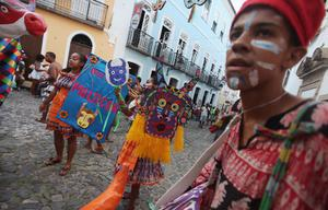 SALVADOR, BRAZIL - FEBRUARY 17:  Brazilians parade on the second day of Carnival celebrations on February 17, 2012 in Salvador, Brazil. Carnival is the grandest holiday in Brazil, annually drawing millions in raucous celebrations culminating on Fat Tuesday before the start of the Catholic season of Lent which begins on Ash Wednesday. Salvador is the capital of the Northeastern state of Bahia and was the first colonial capital of Brazil. Police strikes in Salvador and Rio de Janiero in recent weeks threatened Carnival and raised questions about the countryÄôs preparedness to host the upcoming 2014 World Cup and 2016 Summer Olympics. Rio de JanieroÄôs Carnival began today, a day later than SalvadorÄôs.   (Photo by Mario Tama/Getty Images)
