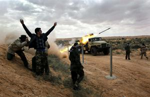 RAS LANUF, LIBYA - MARCH 09:  Libyan rebels fire rockets at government troops on the frontline on March 9, 2011 near Ras Lanuf, Libya. The rebels pushed back government troops loyal to Libyan leader Muammar Gaddafi towards Ben Jawat. (Photo by John Moore/Getty Images) *** BESTPIX ***